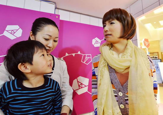 pop idol robot japan Pop idol Japanese robot converses with customers at Takashimaya Osaka store